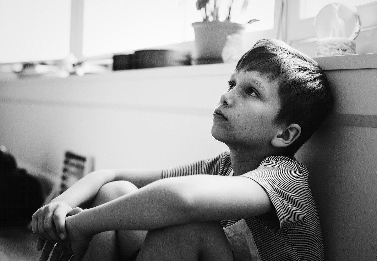 Young boy feeling sad and angry