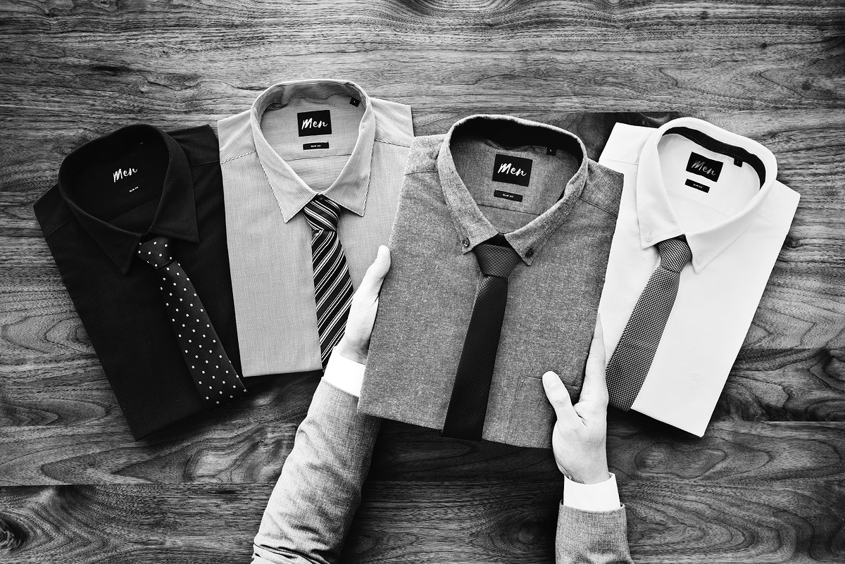 Businessman selecting shirts to wear