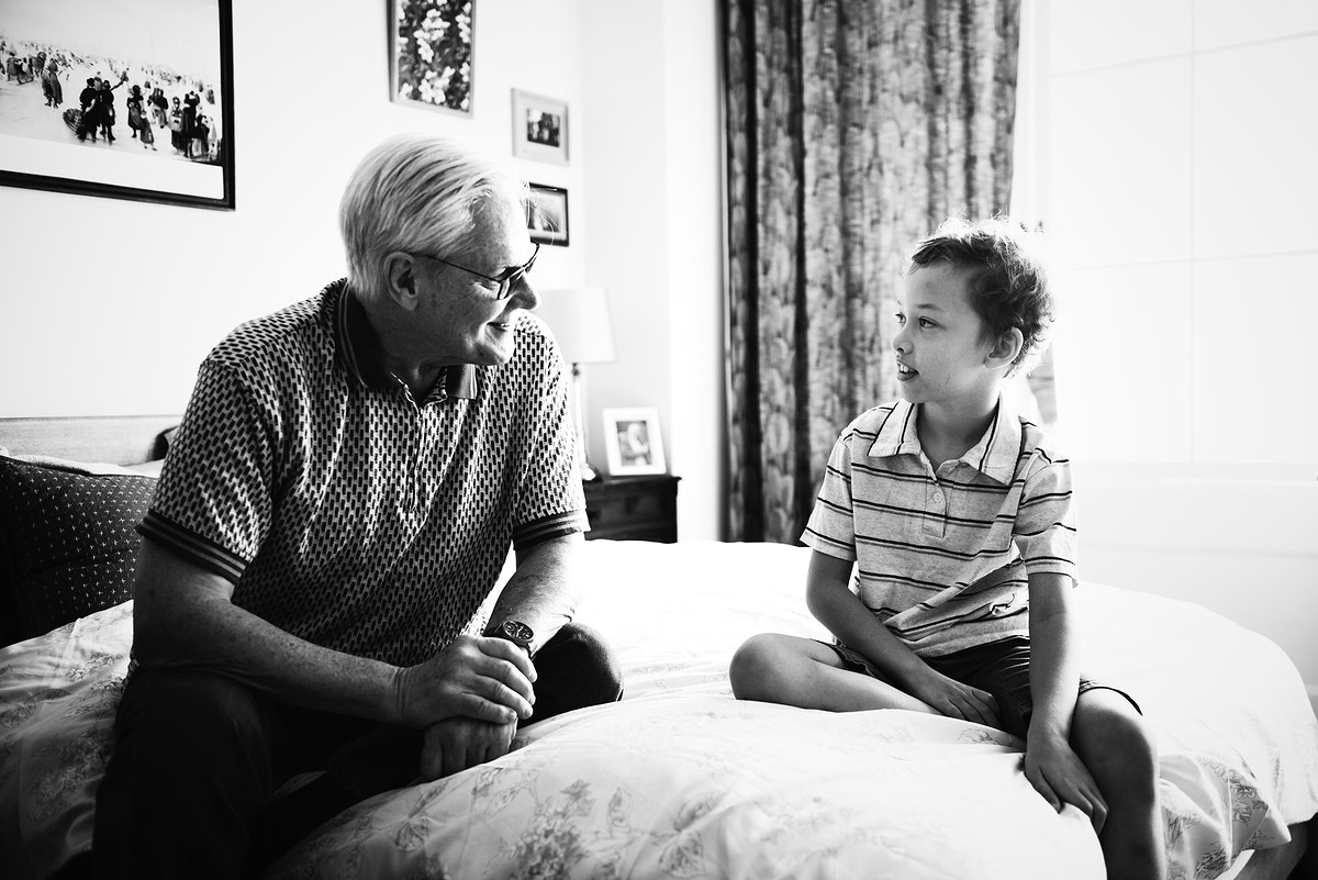 Grandpa and grandson sitting on the bed