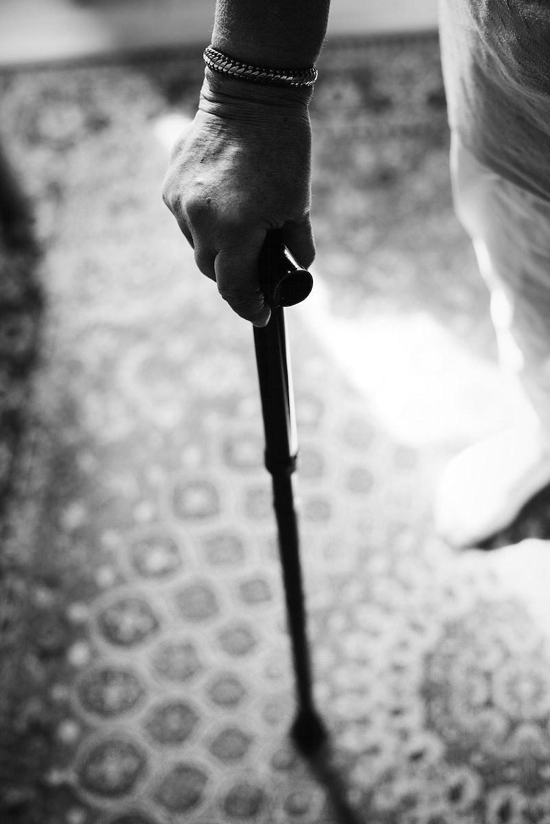 Senior woman using a cane