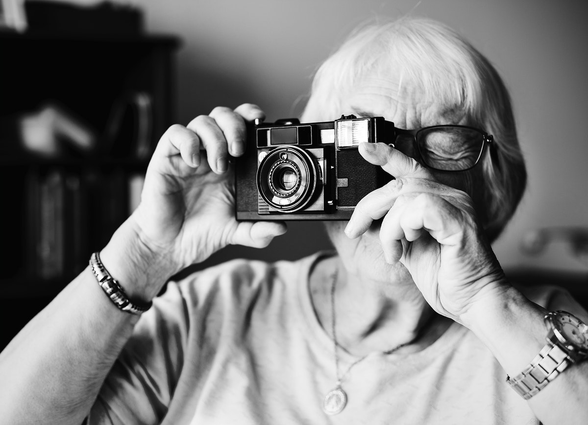 Senior woman taking a picture by camera