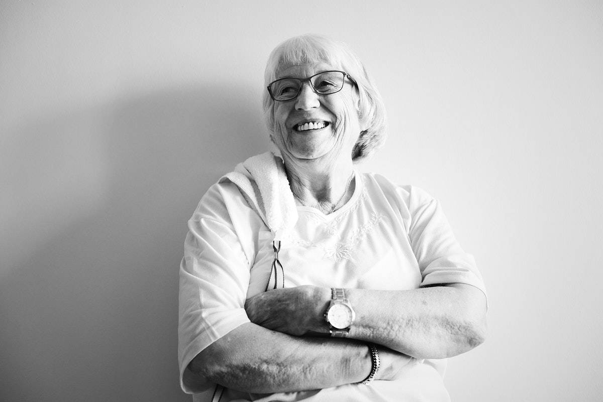 Senior woman arms crossed and smiling