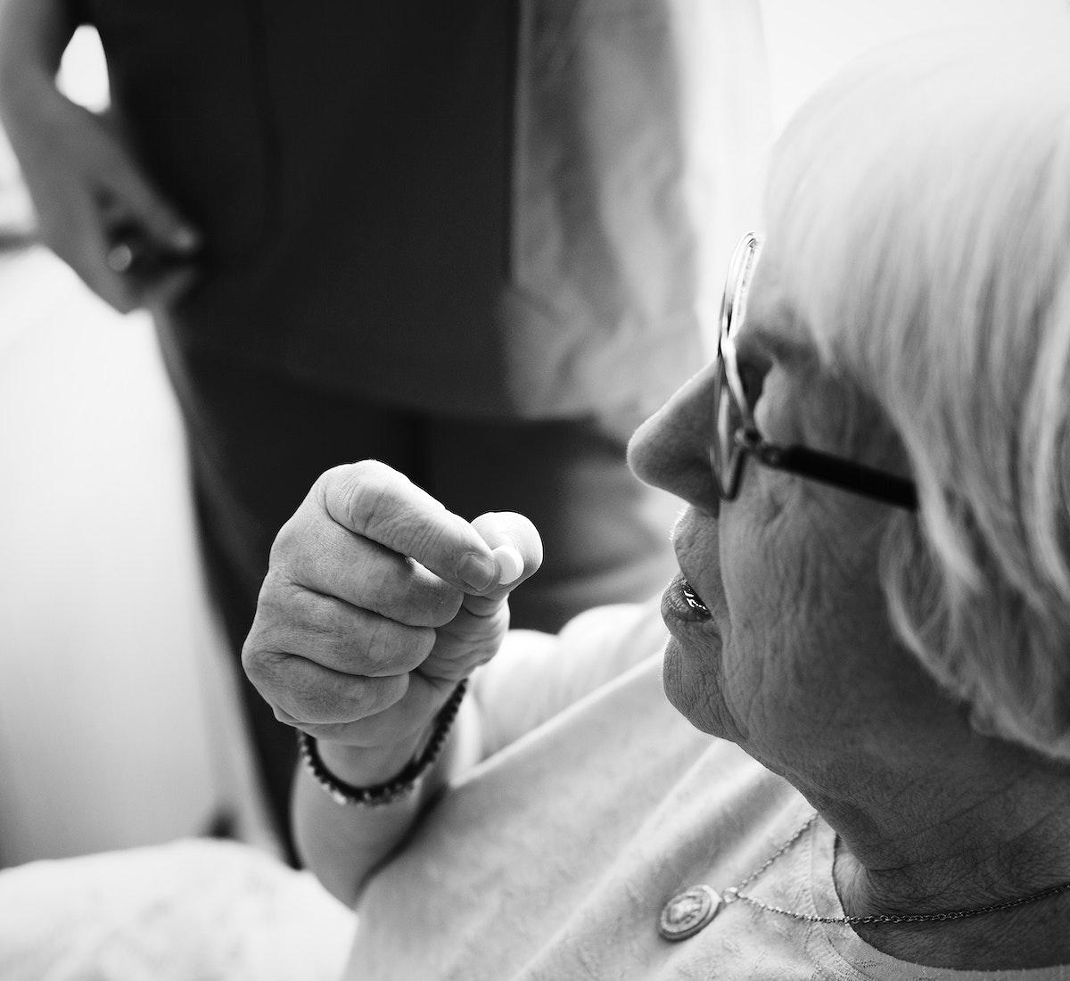 Senior woman taking some medicine