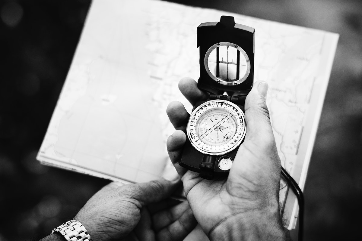 Man checking direction on a compass