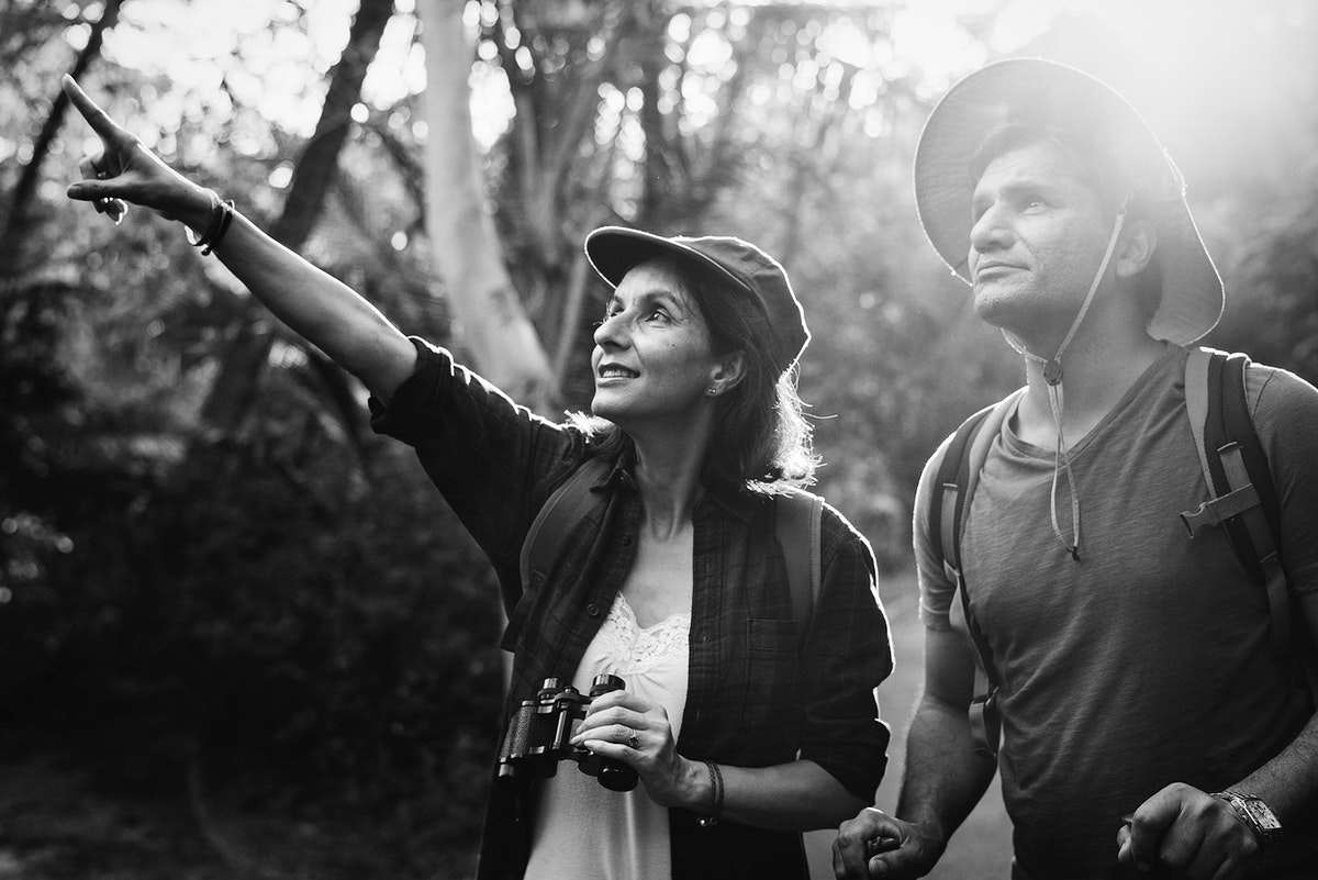 Couple trekking together in the forest
