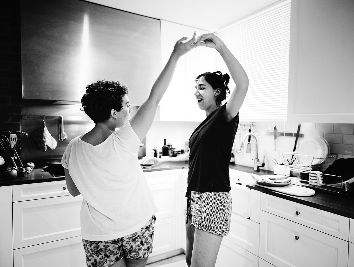 Lesbian couple dancing in the kitchen