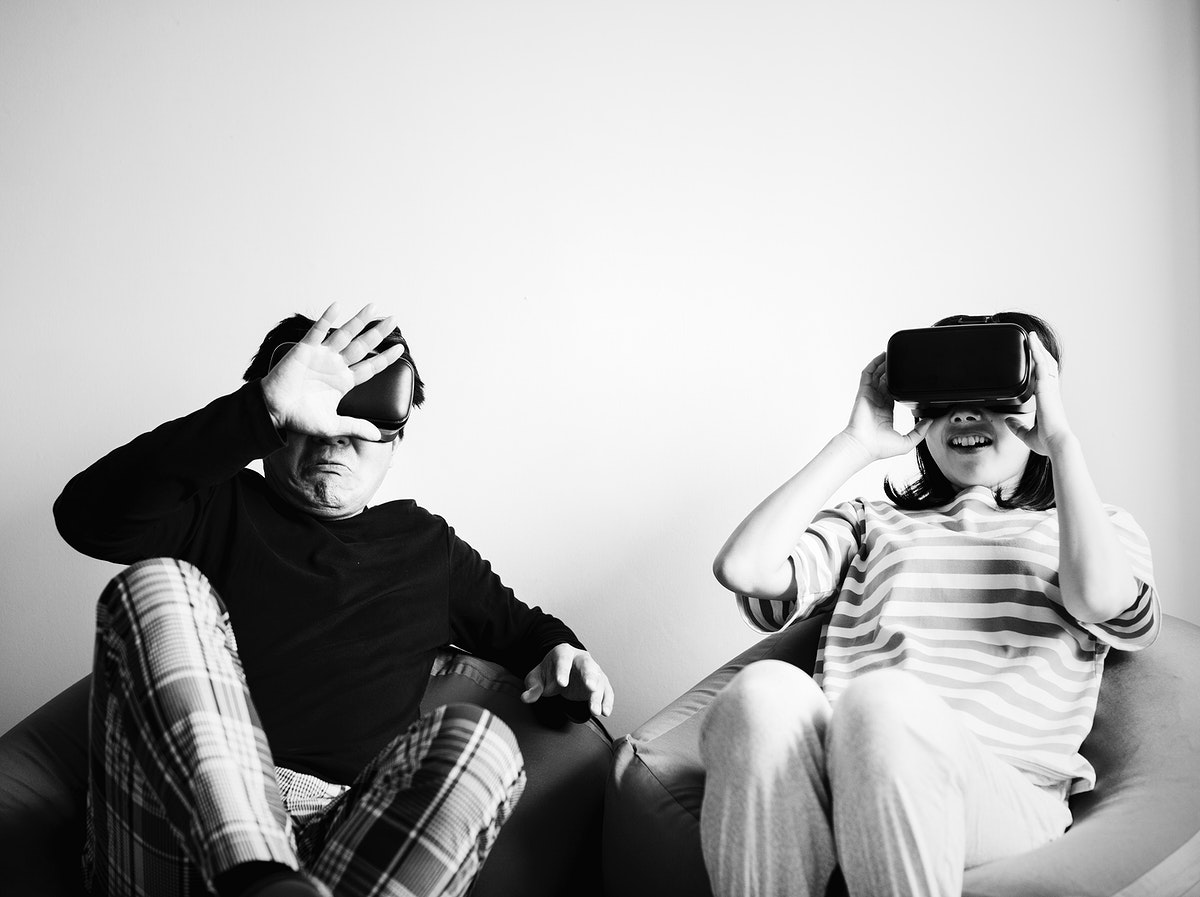 Asian couple experiencing virtual reality with VR headset