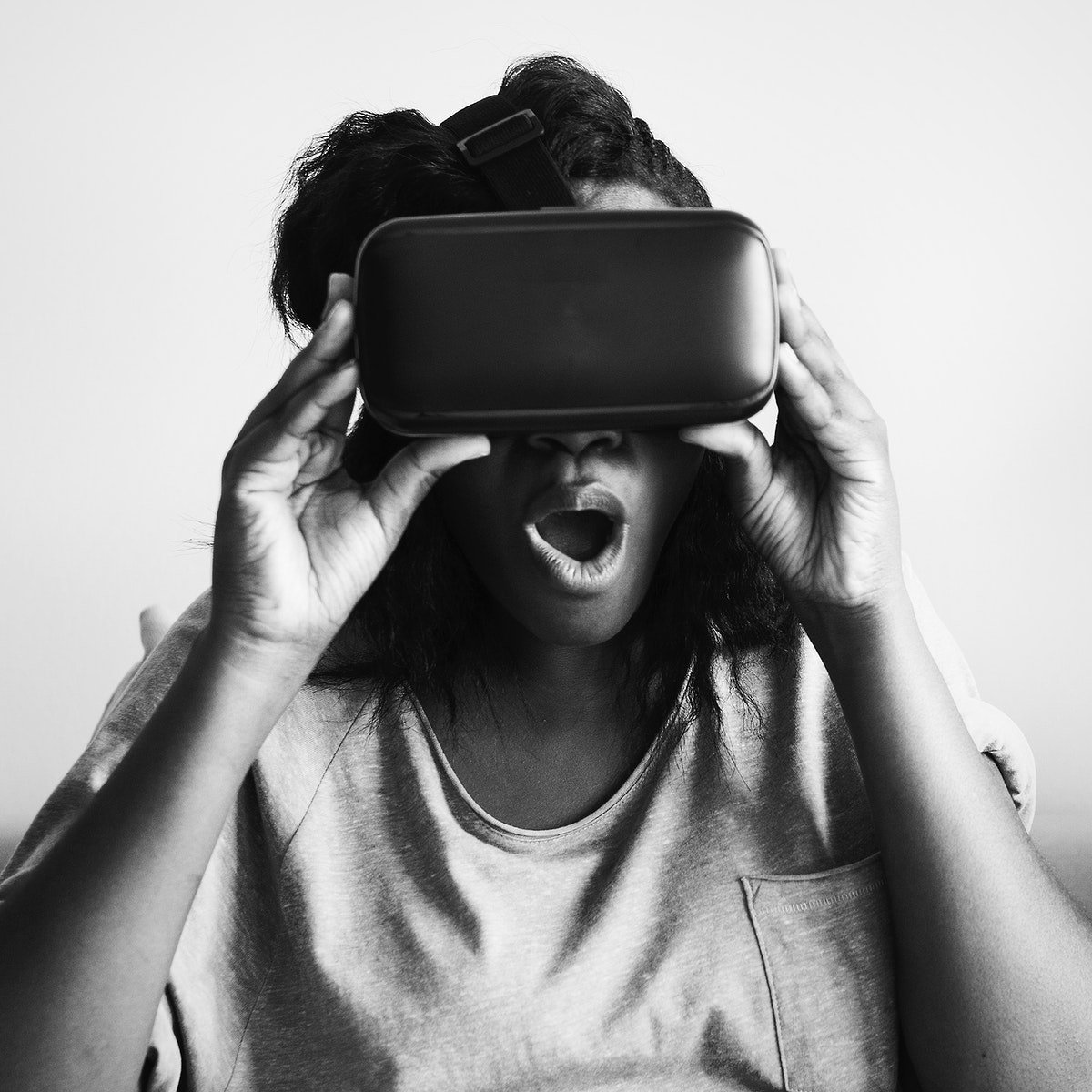 Woman experiencing virtual reality with a VR headset