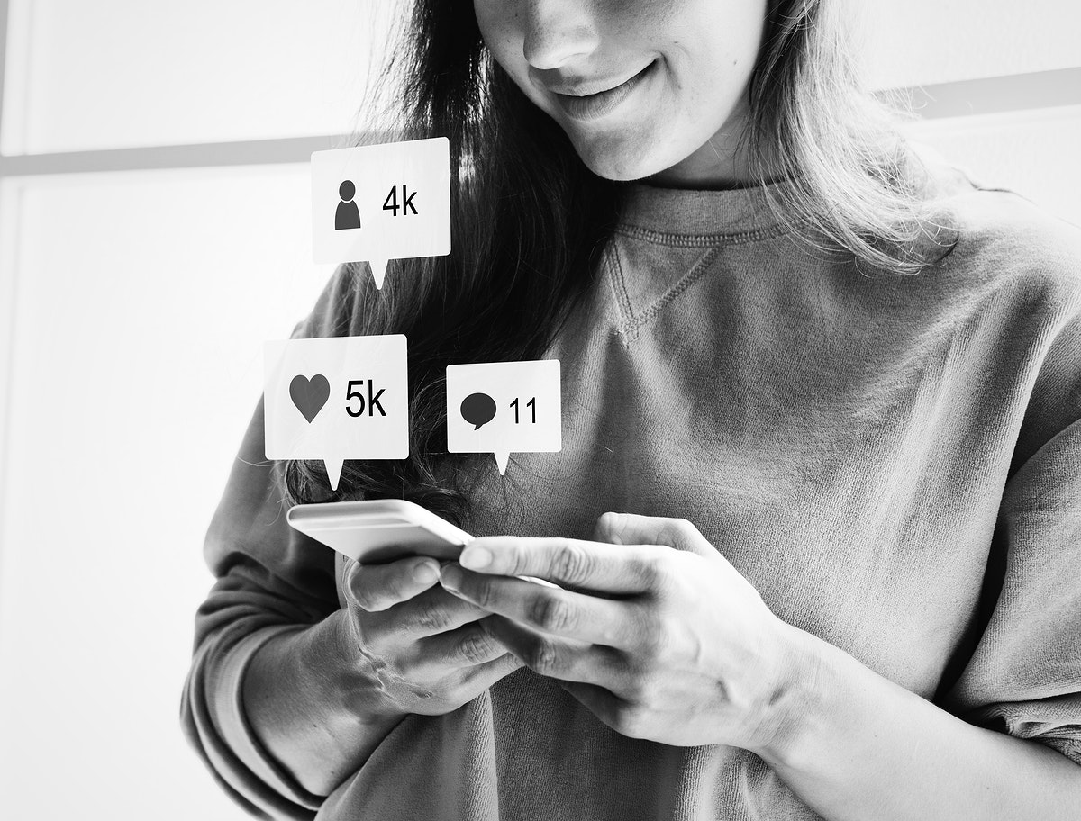 Woman using a smartphone and smiling