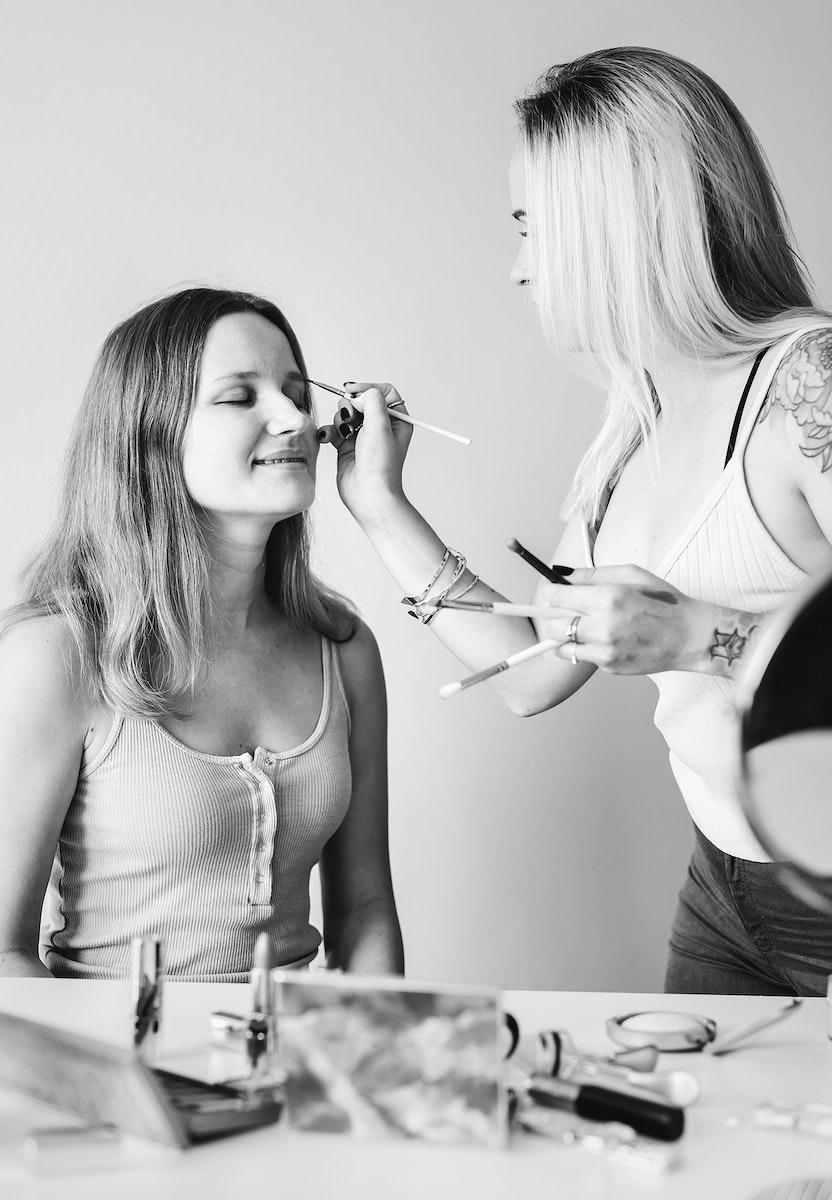 Artist applying makeup on a client