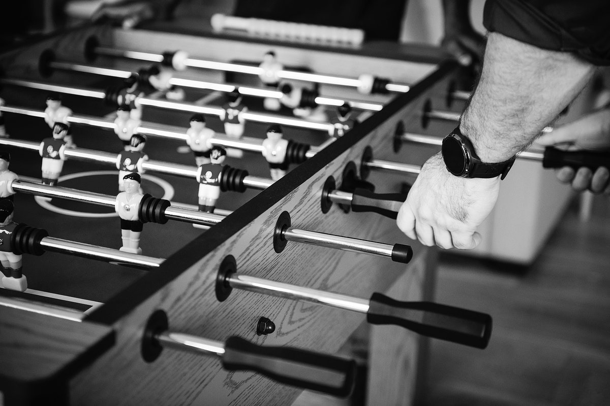People playing table football together