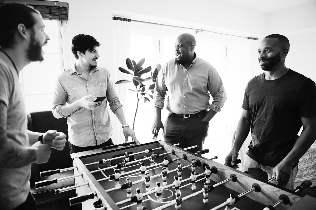 People playing foosball together at home