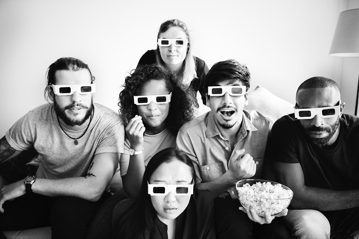 Group of friends watching 3D movie together