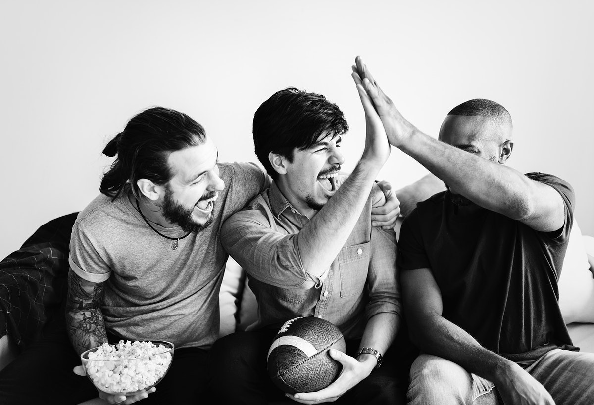 Friends watching American football at home