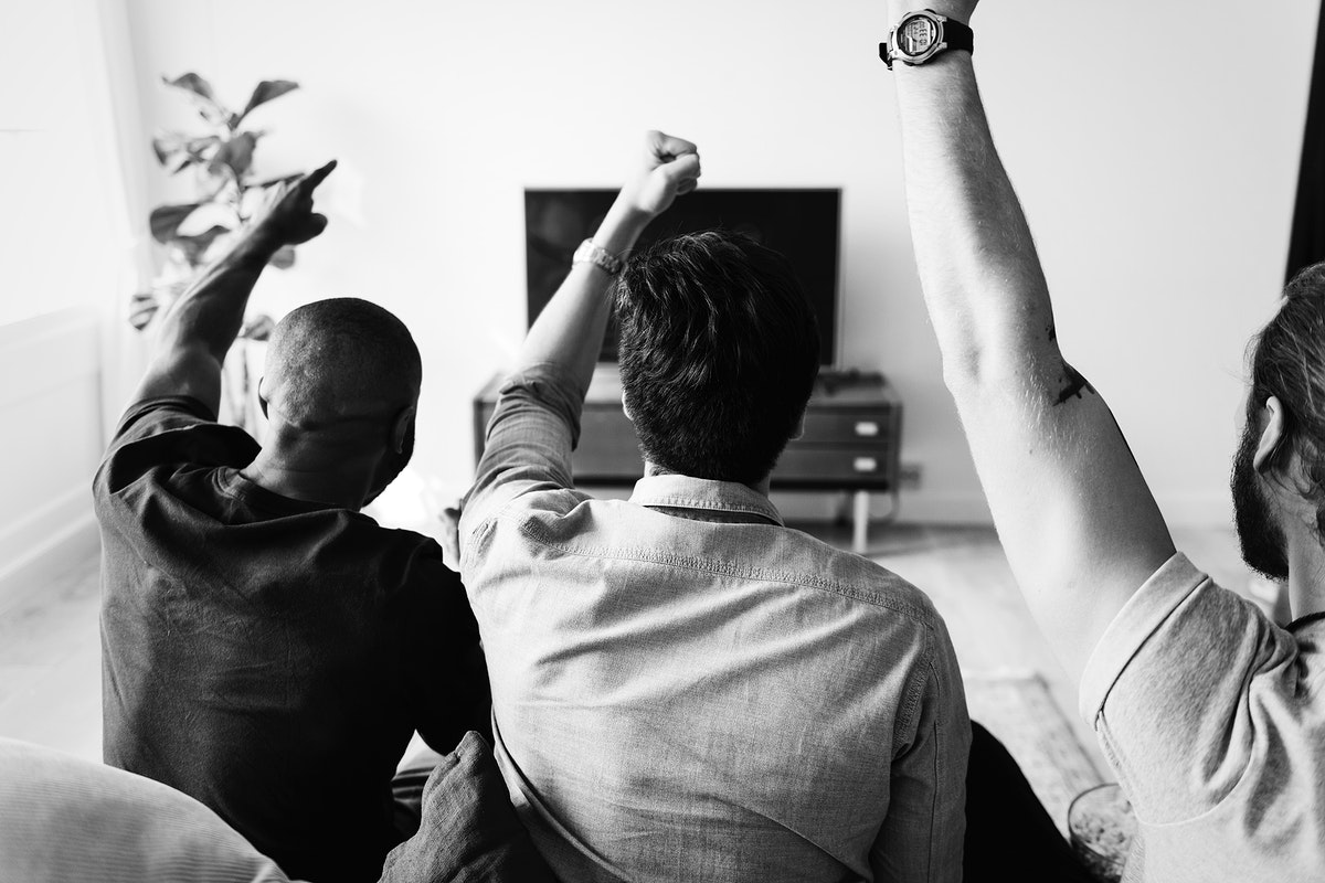 Friends watching sports in the living room
