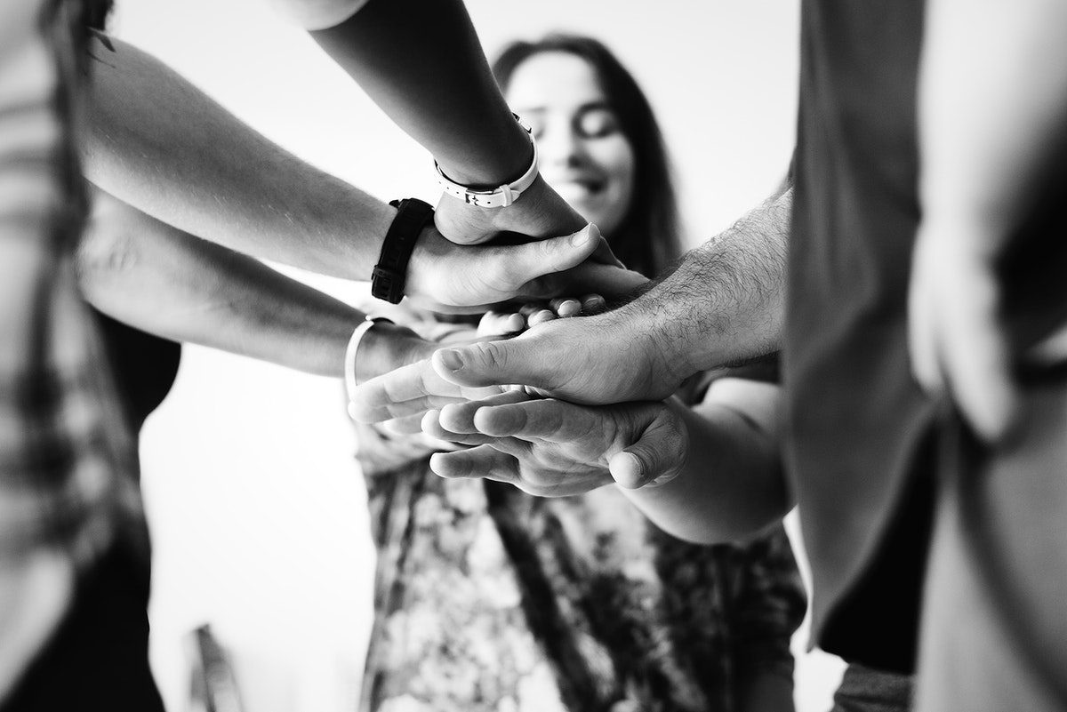 Group of diverse people joined hands