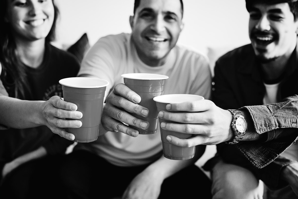 Friends cheering with beer cups