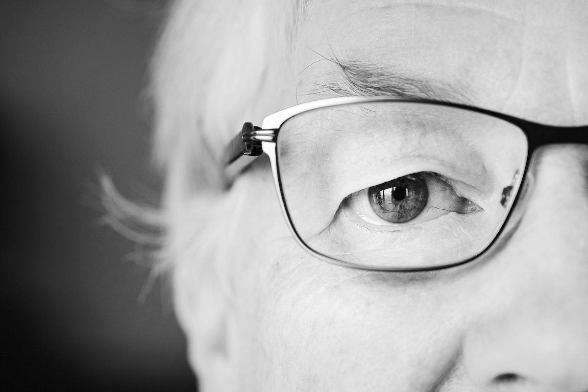 Portrait of elderly woman closeup on eyes wearing glasses