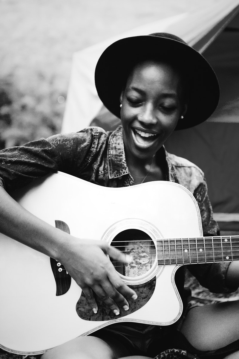Woman playing a song on a guitar