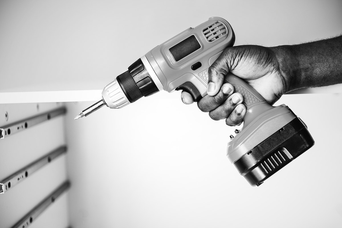 Man using an electronic drill