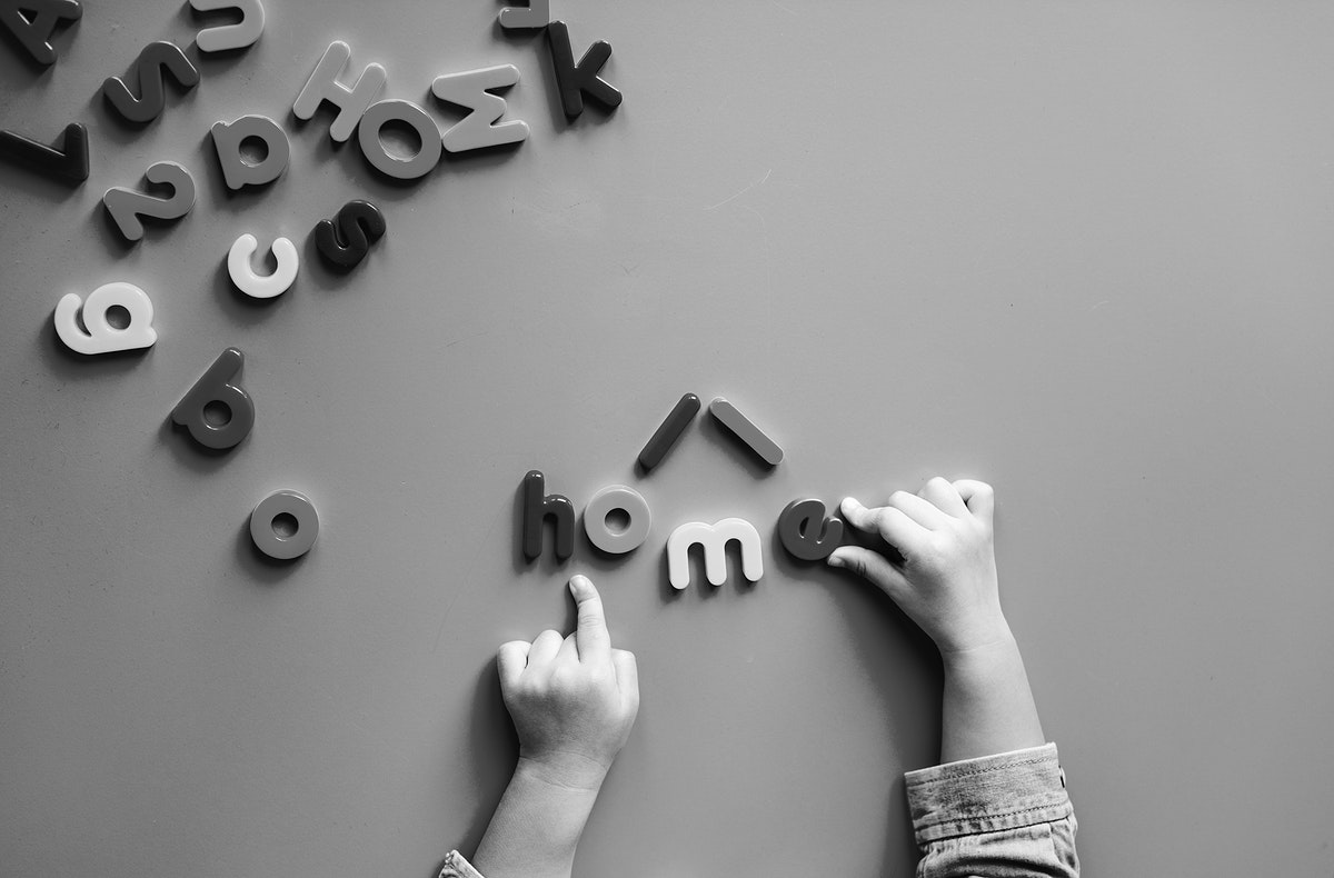 Kid playing with alphabet letters