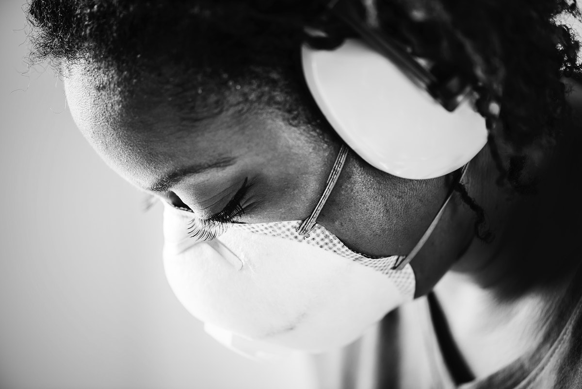 African woman wearing ear protection
