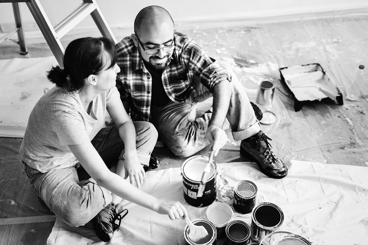 Happy couple renovating a new home