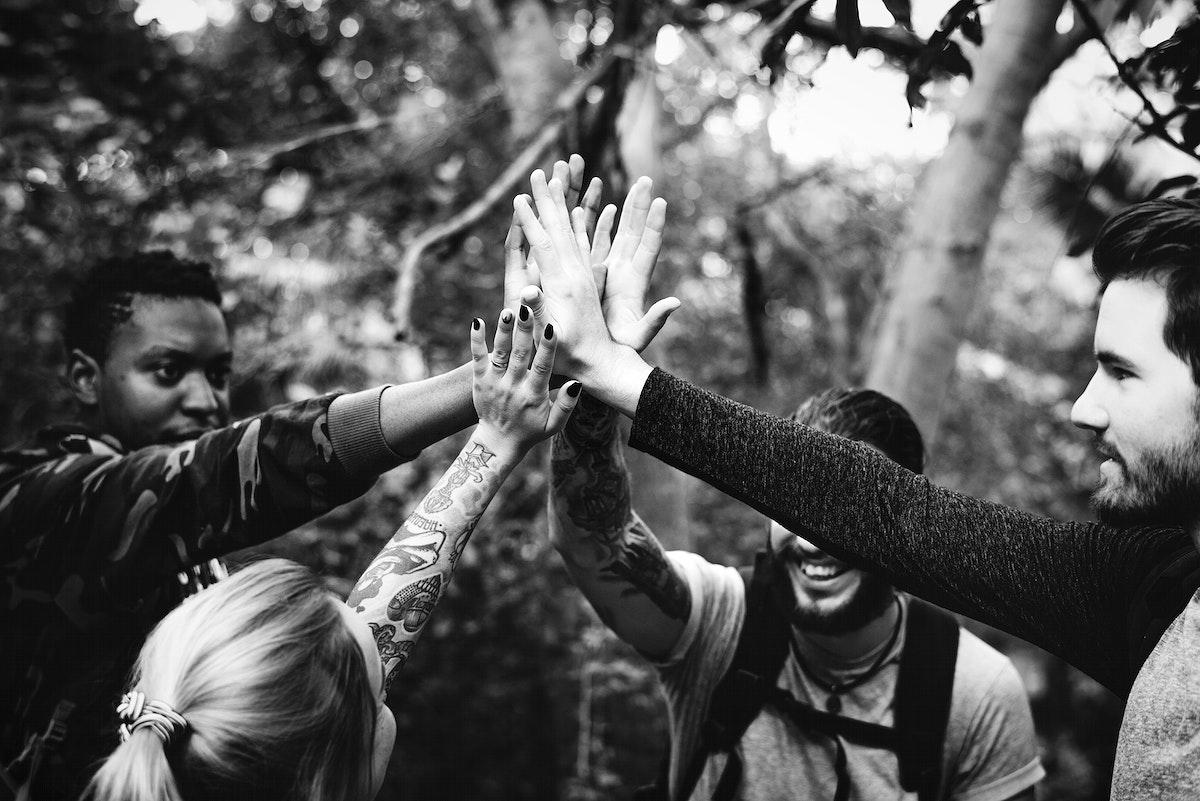 Friends trekking in a forest