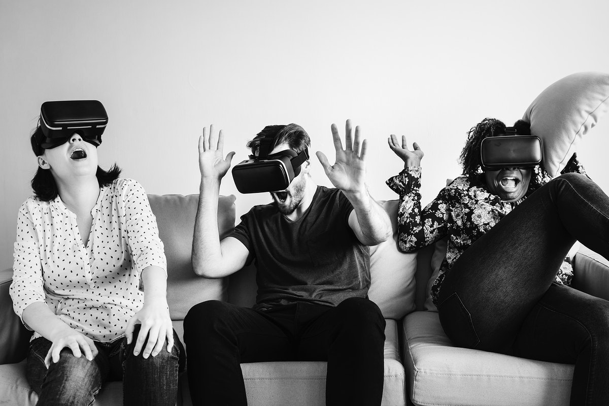 Group of diverse friends experiencing VR