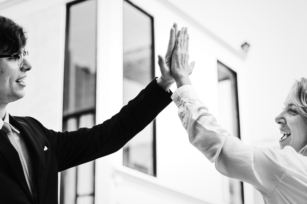 Businesspeople giving a high five