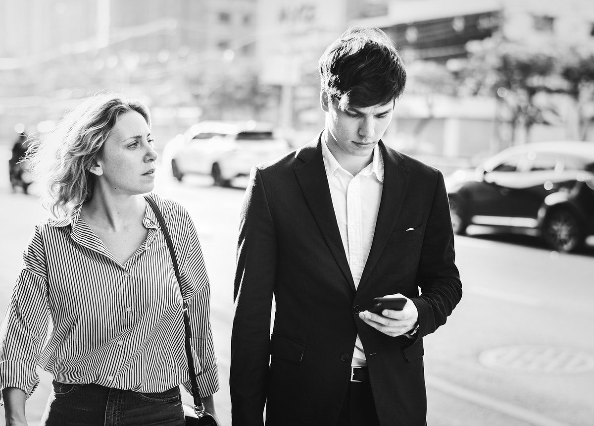 Couple walking in downtown together