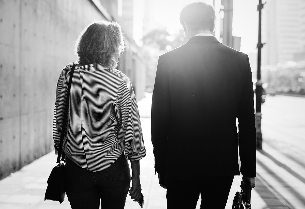 Couple walking on the pavement