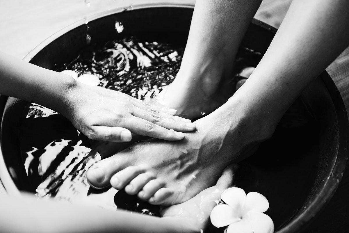Closeup of foot spa therapy and massage