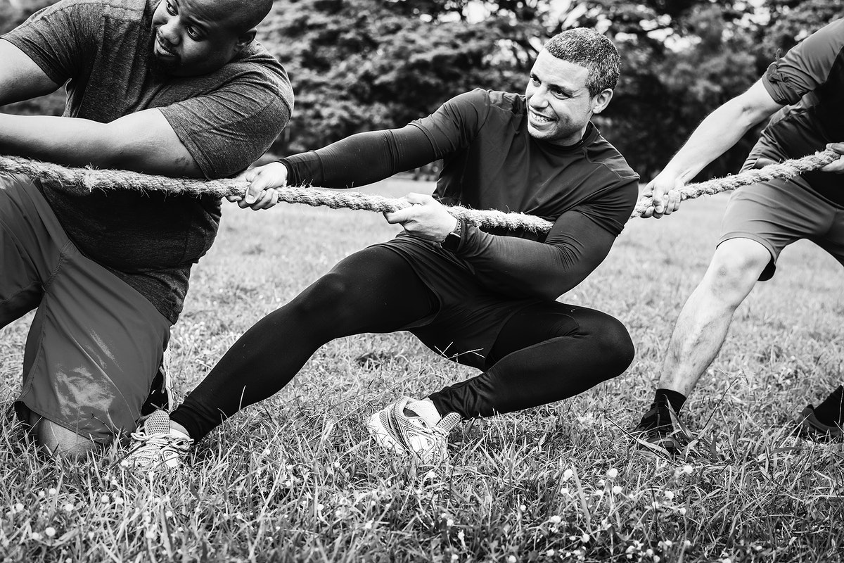 Team competing in tug of war