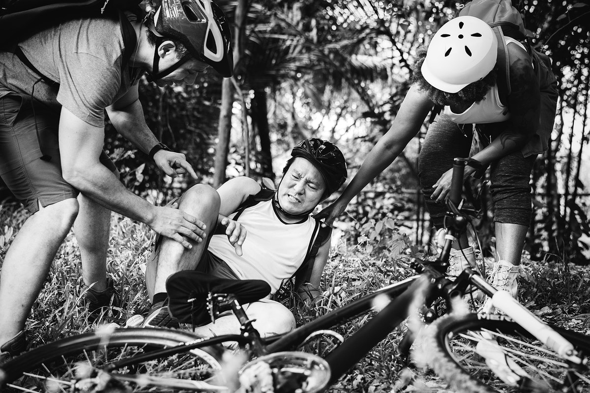 An injured cyclist in the forest
