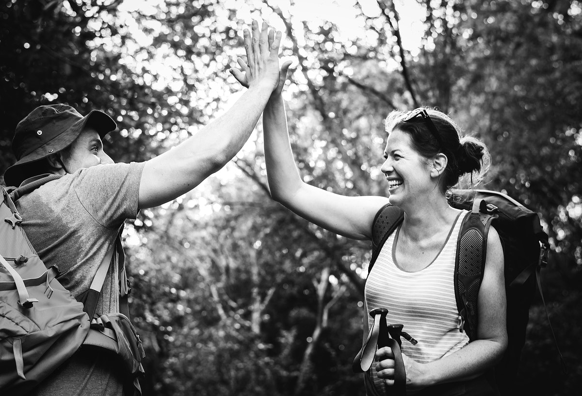 Couple giving a high five