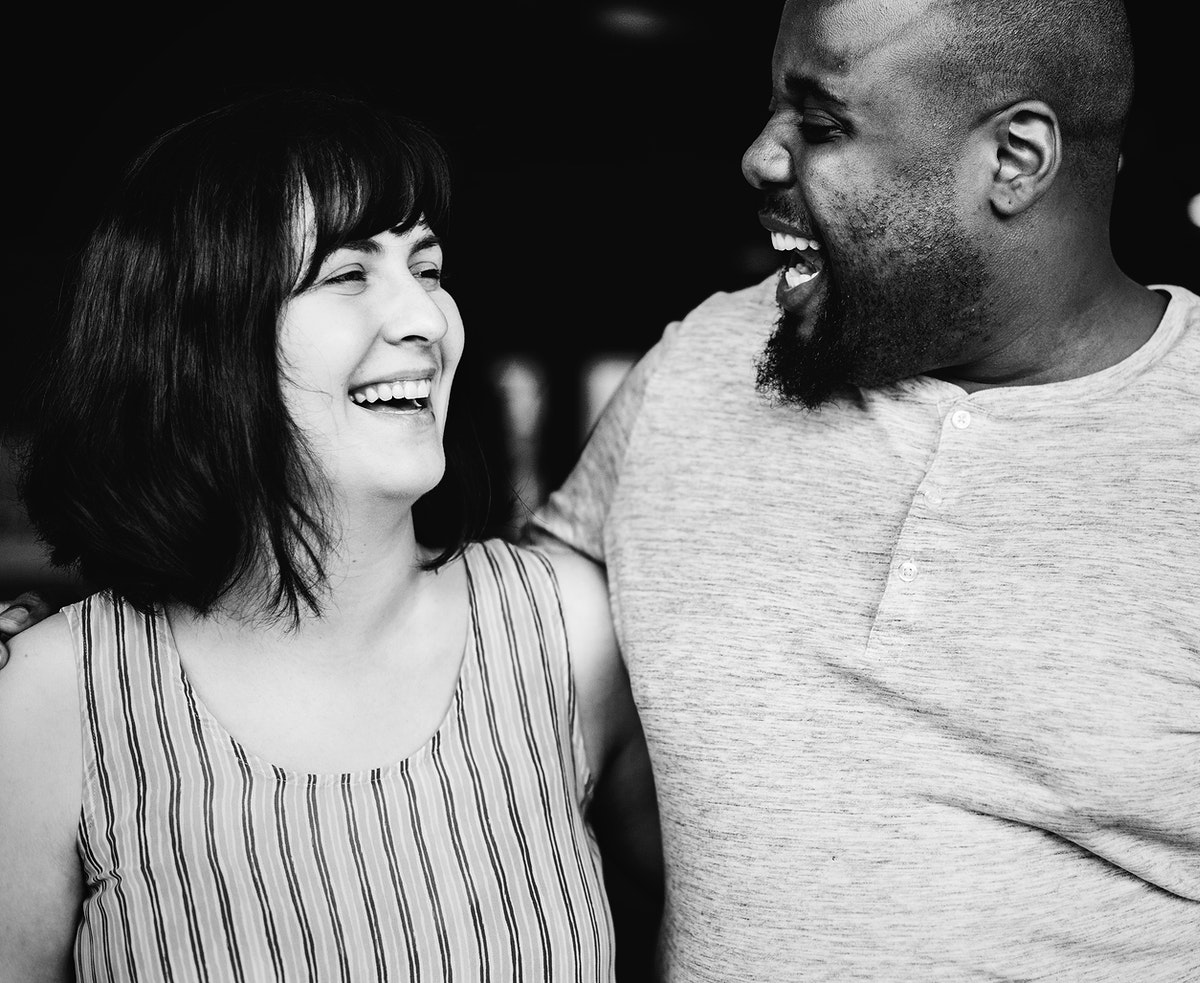 Happy  diverse couple laughing together