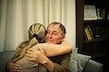 Daughter hugging her elderly father