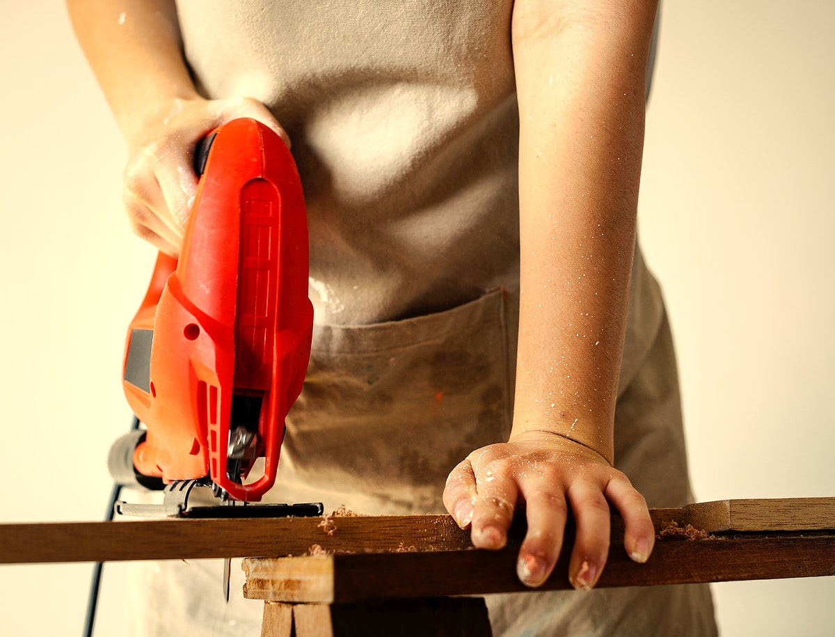 Woman using an electrical saw