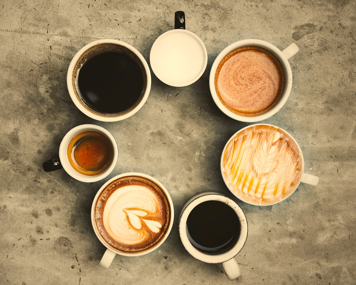 Variety of cups with hot coffee