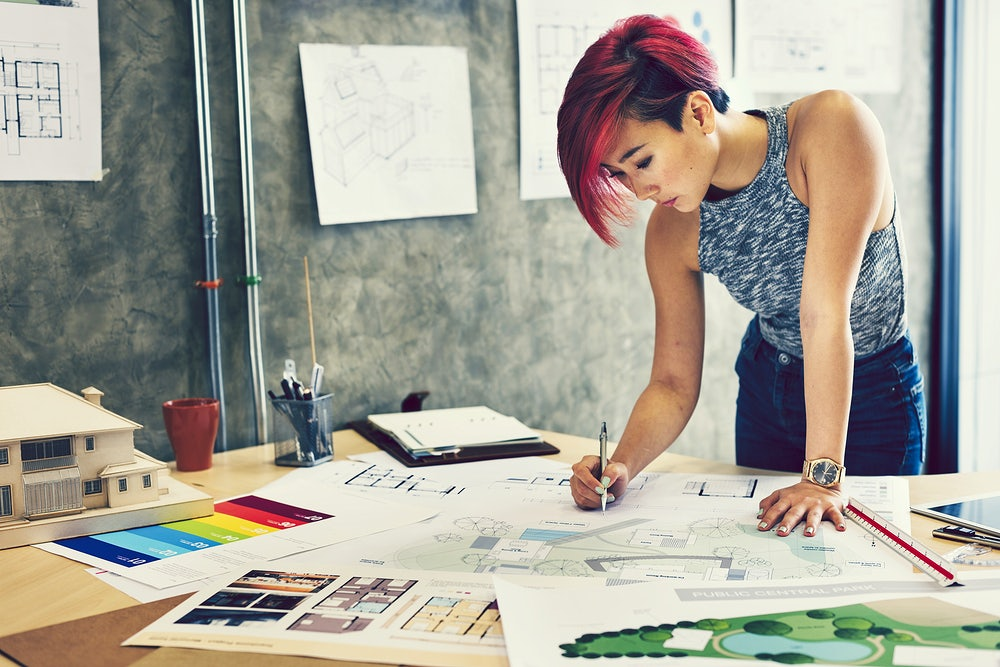 Red haired architect planning a project