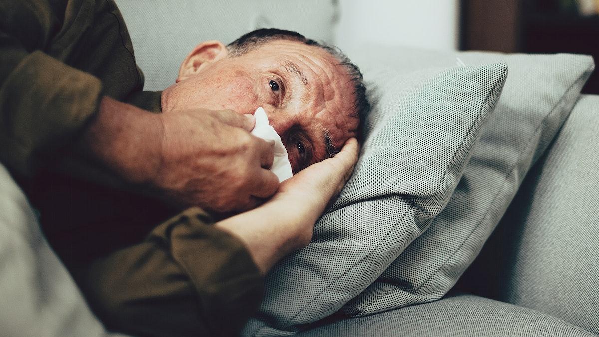 Sick elderly man having coronavirus symptoms