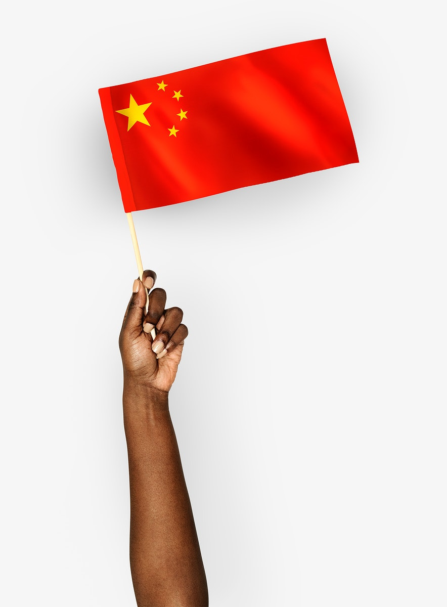 Person waving the flag of the People's Republic of China