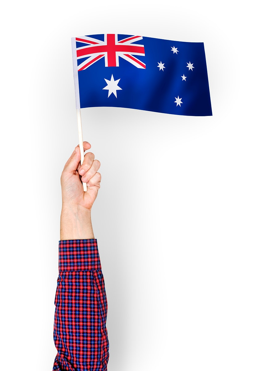 Person waving the flag of Commonwealth of Australia