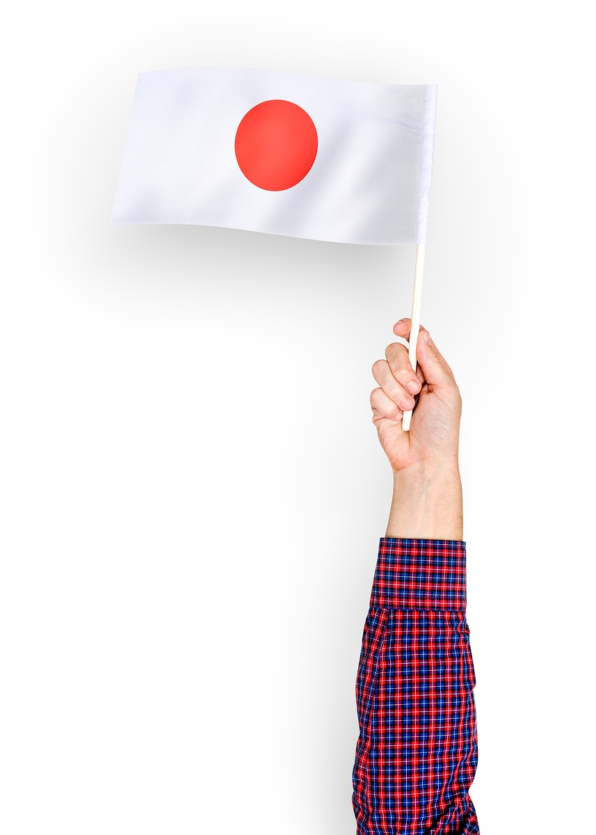 Person waving the flag of Japan