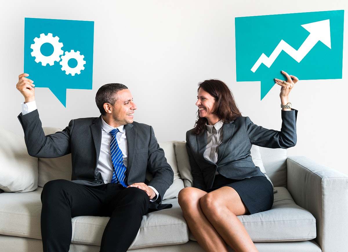 Business people holding speech bubbles with growth icons