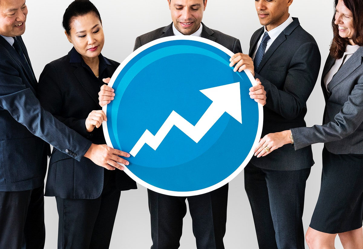 Diverse business people holding a growth icon