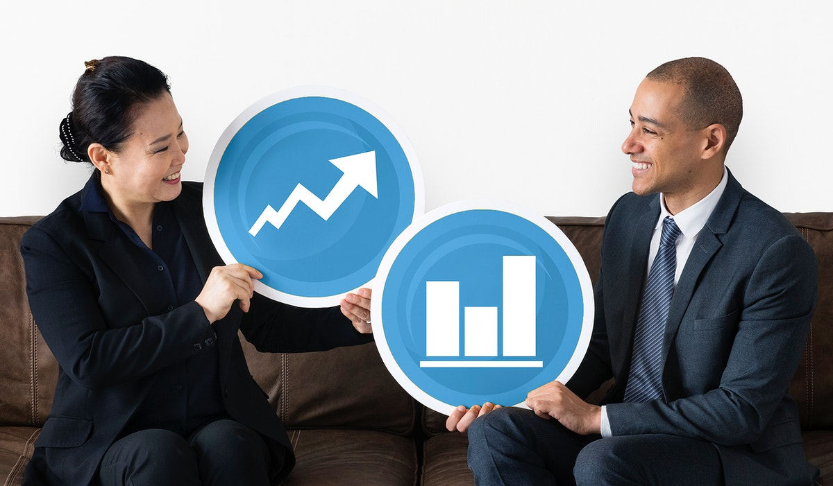 Business people holding graph icons