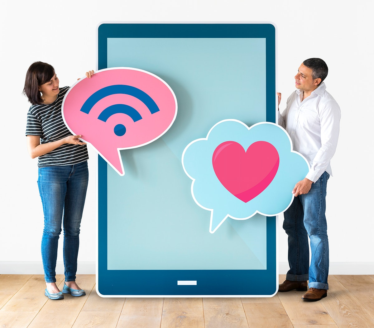 Couple holding a big digital tablet