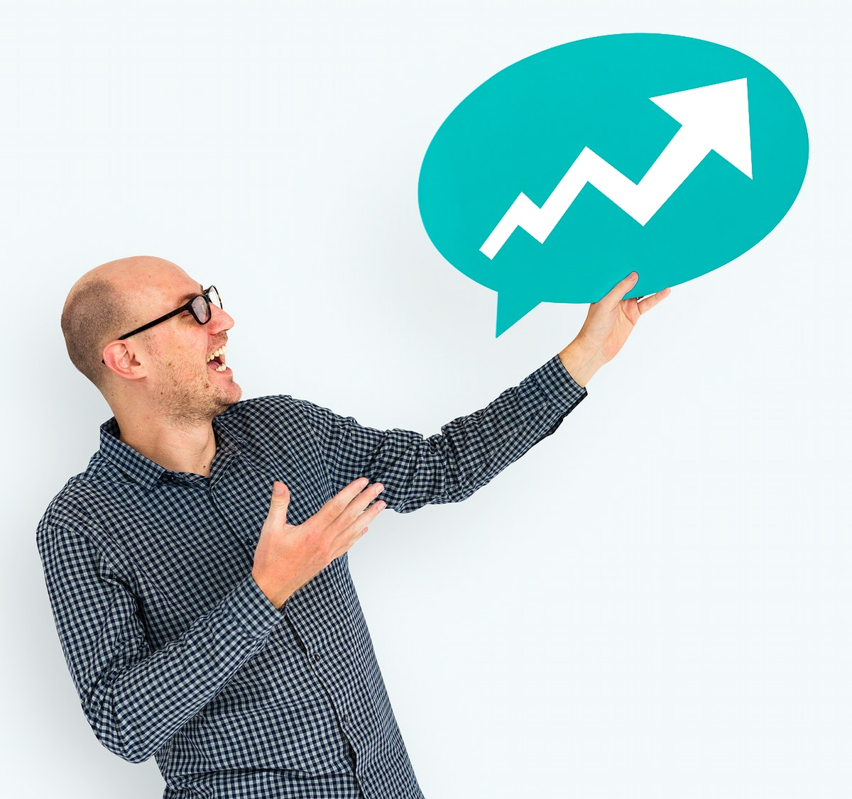 Businessman holding speech bubble with growth icon